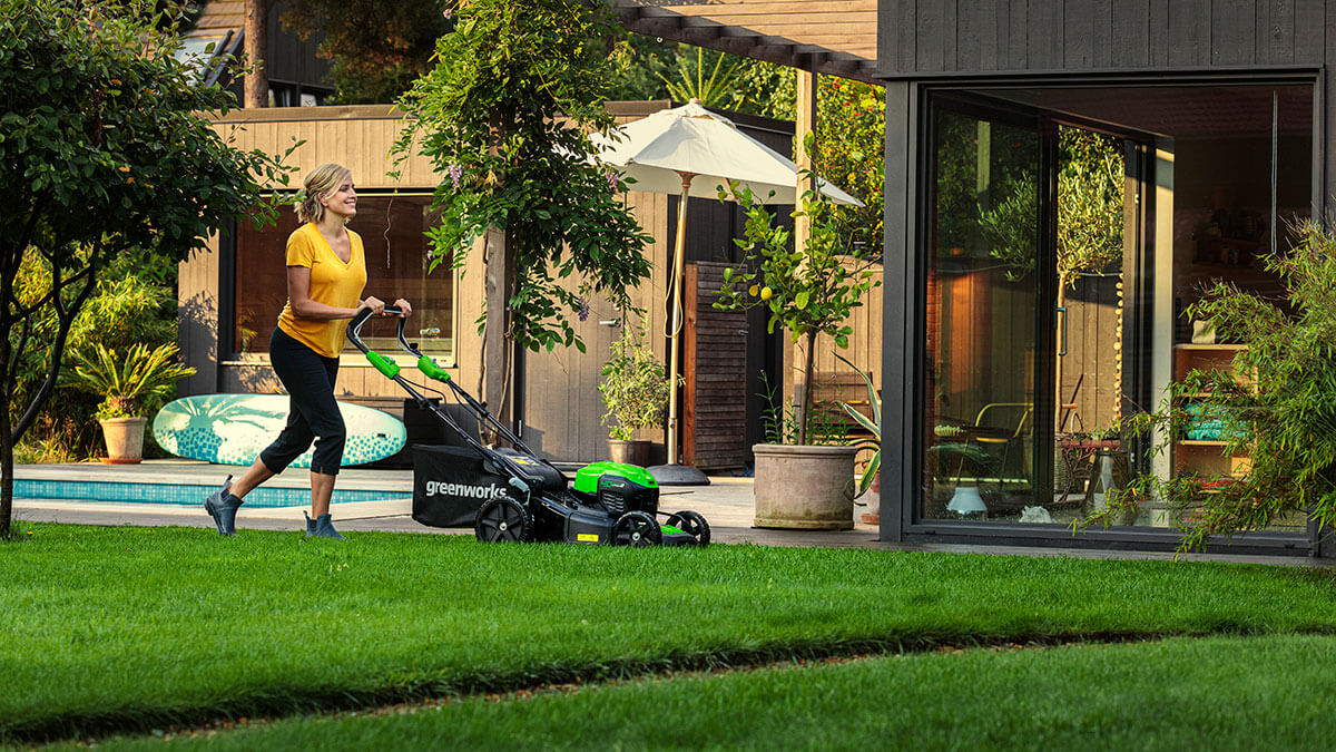 Woman cutting the lawn